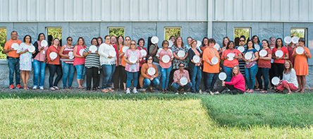 STAFF DON ORANGE FOR HUNGER ACTION MONTH AWARENESS INITIATIVE